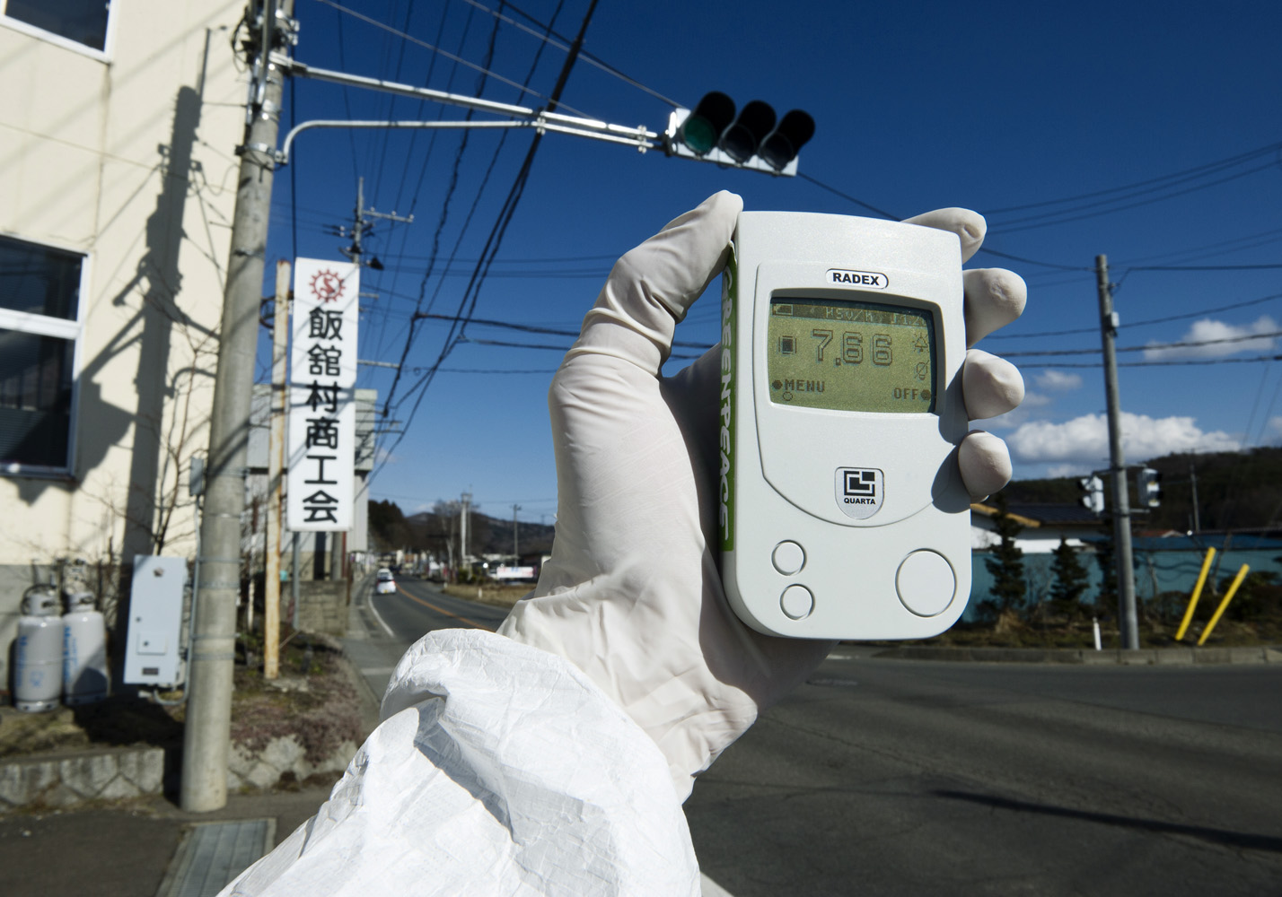 Iitate, Fukushima Prefecture  Japan, 27 March 2011  Greenpeace monitoring radiation levels far above legal limits. The geiger counter showing 7.66 micro Sievert per hour, and within 6 days people would receive a yearly dose of radioactivity. Iitate is located more then 40 km from Fukushima Nuclear Power Station and the village has still not been evacuated.