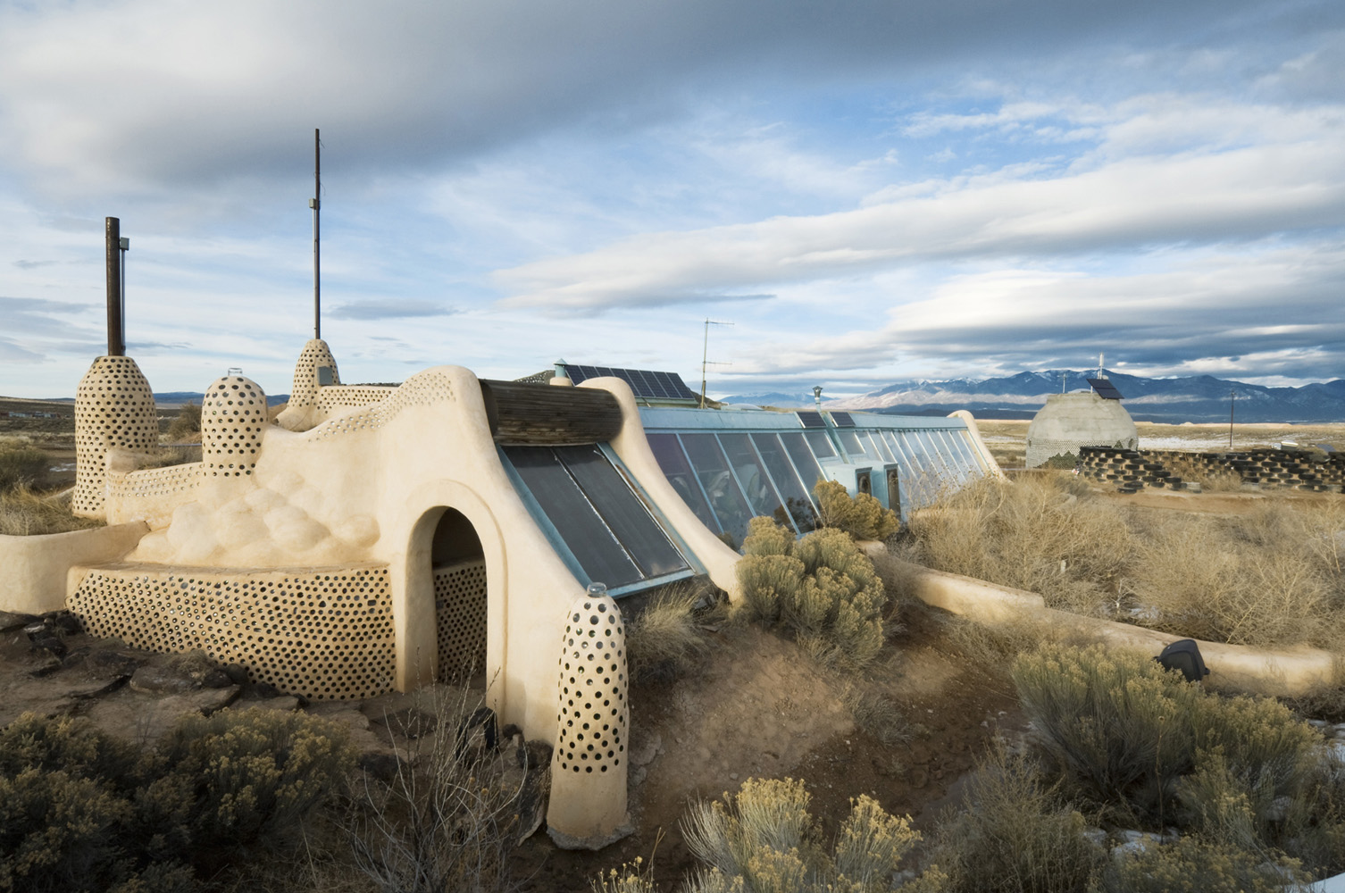 Taos, New Mexico, USA.Earthship house. A New Mexico style of house made out of recycled material; car tires, cans and bottles. Earthships are self-sustainable with water harvesting, solar and wind electric power and Solar/Thermal heating and cooling.