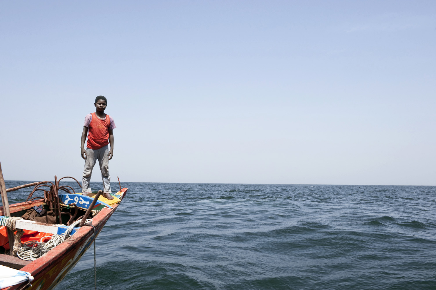 Atlantic Ocean, Senegal, 18 March  2010 Young boy on the Senegalese Pirogue fishing boat 'Sophie Fall' 46 nautical miles offshore, out fishing for 10 days.
