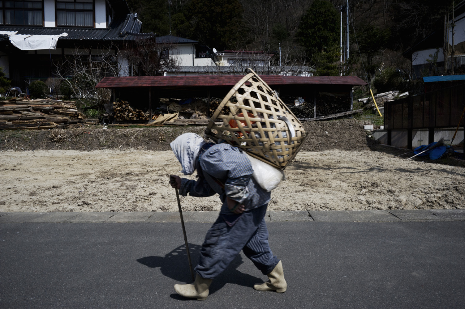 Koriyama,  Japan, 7 April 2011 - An elderly farmer carries a basket of produce on the outskirts of Koriyama City, 60 km south of the Fukushima Daiichi Nuclear Power Plant. Greenpeace is working in the area to monitor radioactive contamination of food and soil to estimate health risks to the local population.