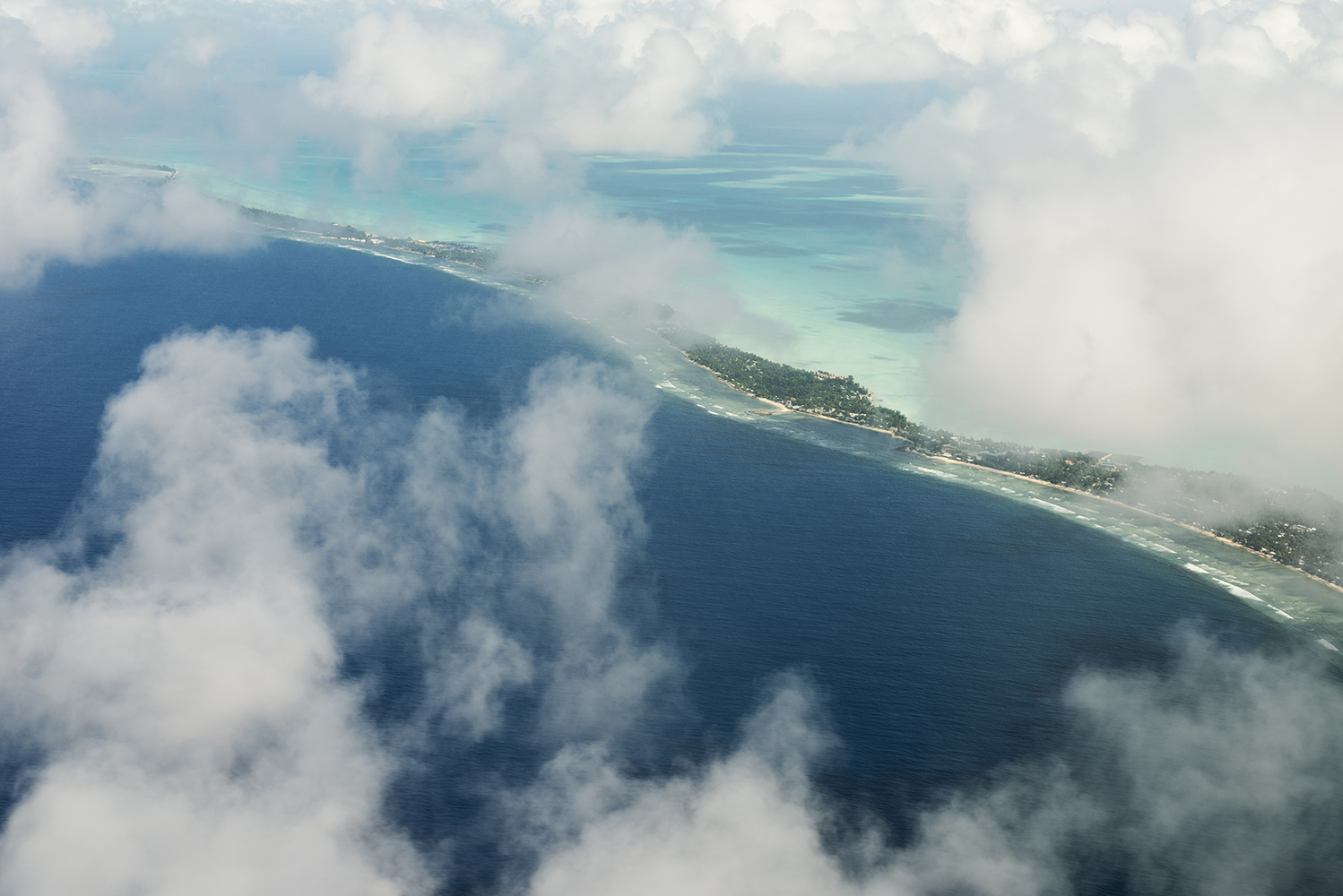 Tarawa Island, Kiribati, Pacific Ocean Aerial view of Tarawa archipelago, Kiribati. The nation is composed by 32 atolls and considered one of the least developed and poorest countries in the world with people whose livelihoods depend on the fish.