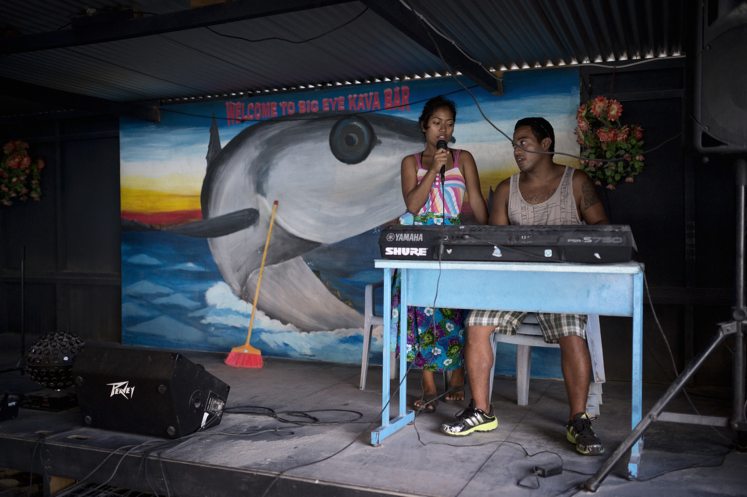 Tarawa Island, Kiribati, Pacific Ocean Karaoke performance on Big Eye Kava bar in the village Te O Ni Beeki, Betio, on Tarawa Island, Kiribati is considered one of the least developed and poorest countries in the world with people whose livelihoods depend on tuna. Since the arrival of foreign fishing vessels in Kiribati waters the catches for the local fishermen has been reduced.