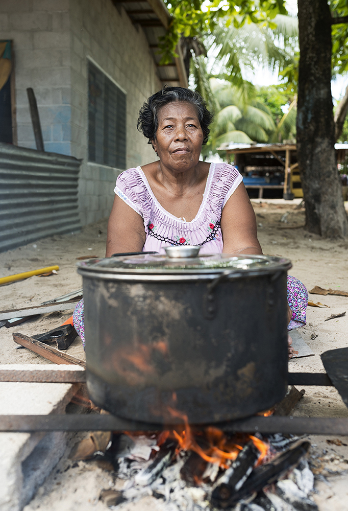 Betio, Tarawa Island, Kiribati, Pacific Ocean Beretita Toukin cooking tuna for her family in the small fishing community Te O Ni Beeki in Betio, Tarawa Island, Kiribati. She wish all the big foreign fishing boats belonged to Kiribati people so they could fish the tuna ourselves, process it there, and then sell it to the world for a better profit.  Kiribati is considered one of the least developed and poorest countries in the world with people whose livelihoods depend on the fish. Since the arrival of foreign fishing vessels in Kiribati waters the catches for the local fishermen has been reduced.