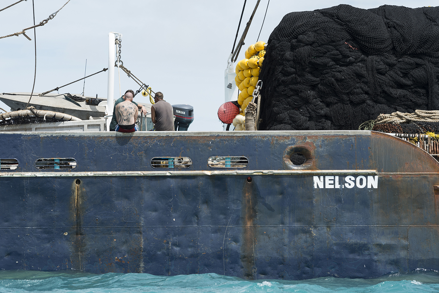 Tarawa Island, Kiribati, Pacific Ocean Purse seine fishing vessel Eagle from New Zealand outside the harbour of Betio, on Tarawa Island, waiting for transhipment of tuna to a reefer ship, a refrigerated cargo ship.