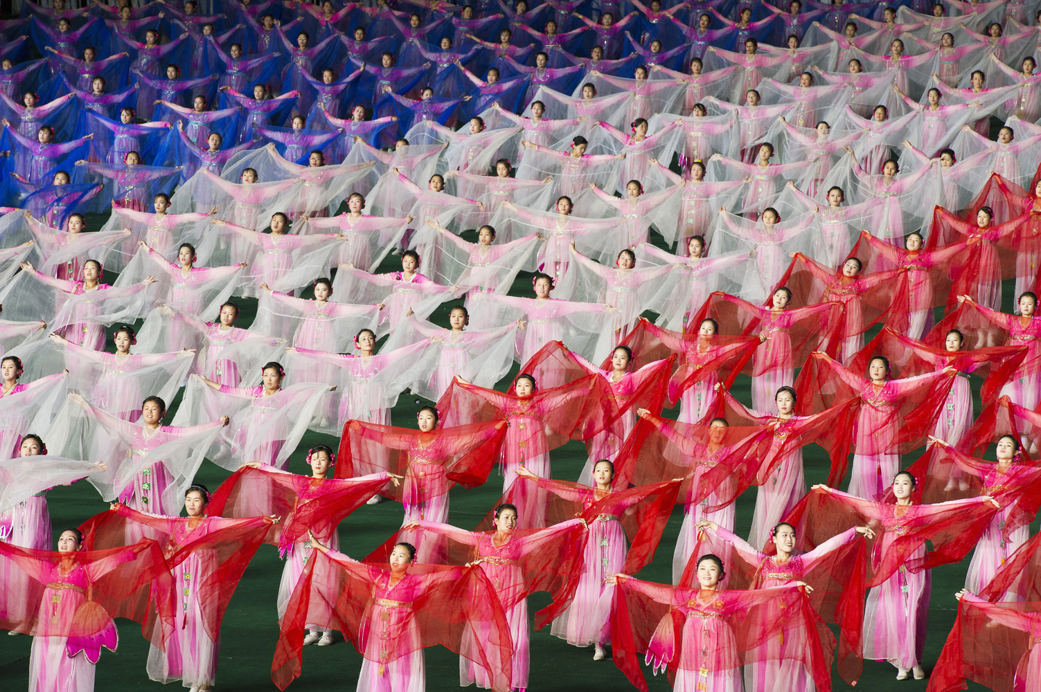Arirang Mass Games at Mayday Stadium in Pyongyang, North Korea,  a 120,000 performer-strong spectacle of gymnastic choreography with military precision, in one of the biggest sport arenas in the world. At the stand behind the field 20,000 person flip card mosaic to form detailed composite pictures.The performance takes place for two months in August and September. From as young as 5 years old kids are being selected to participate in the Mass Games.