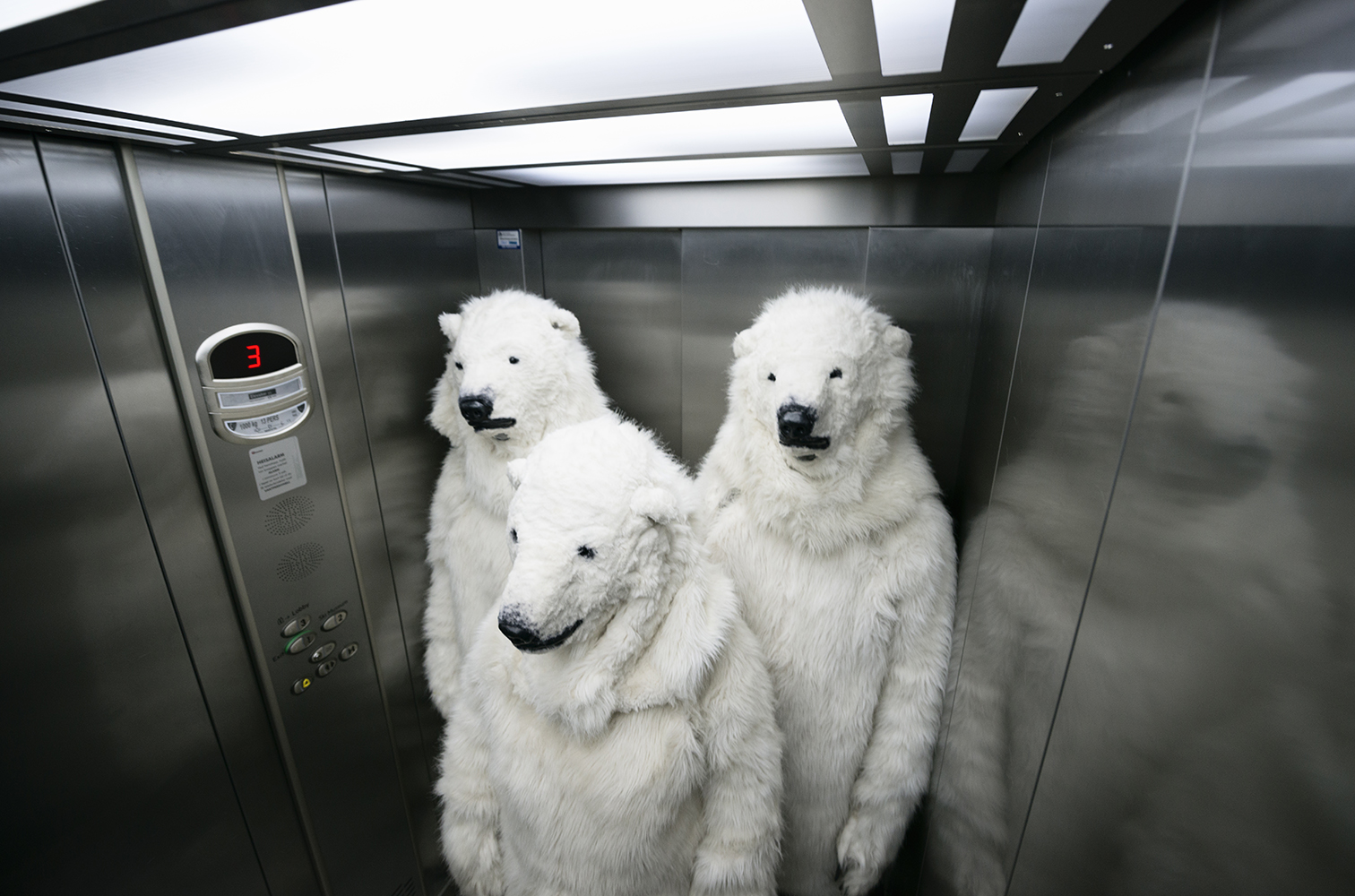 130214 Oslo, NorwayPolar bear activists in an elevator during Oslo Energy Forum with demands to the oil industry  to stay out of the Arctic.