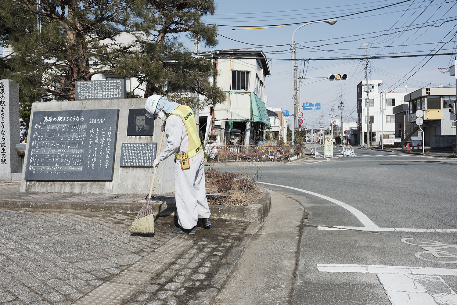 Fukushima radiation cleanup worker in the abandoned city Namie, located between 5-15 km north of the Fukushima Daiichi Nuclear Power Plant. The city had a population of 18000 people that was evacuated after the disaster. The evacuation area around Fukushima Daiichi is divided in 3 zones. Namie is now on the border of zone 2 and the highest zone 3 where people are not allowed to move back for a long time. Zone 2 is the area that is being prepared for people to return to, as early as 2017 when evacuated citizens will loose their right to the limited compensation they are now receiving. Even after decontamination, most of the area remains dangerously radioactive.According to Greenpeace, it is unacceptable to force the population to return to an area that is still significantly contaminated, even after cleaned up.