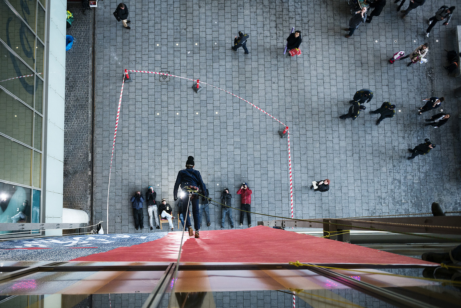 Activists stage a 'vertical catwalk' action in front of the Levi's store in the biggest mall in Copenhagen, Denmark. They call Levi's to engage fully in the process of ending the use and release of hazardous chemicals in connection with the production of their clothing.