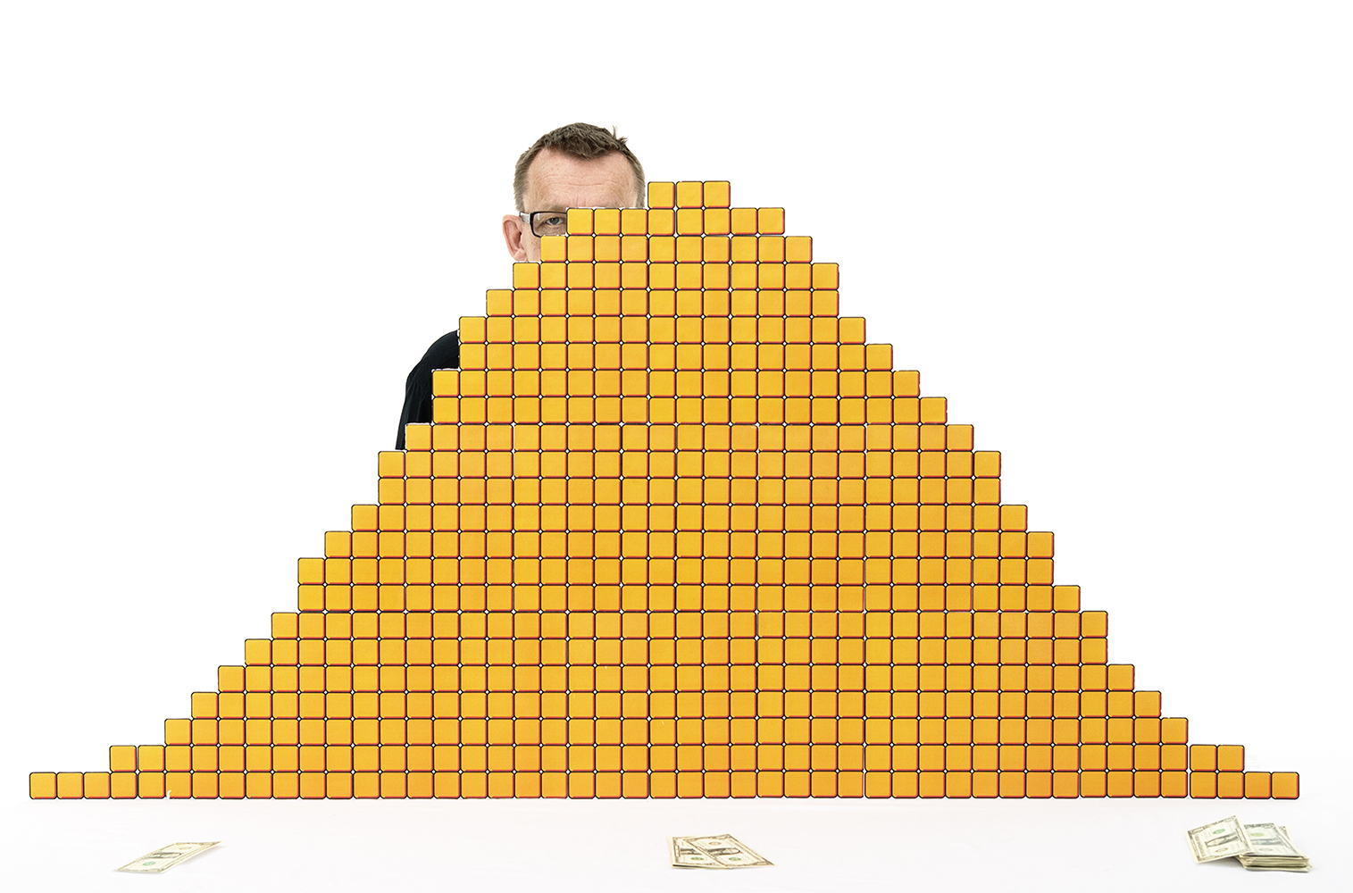 Portrait of global health expert and statistician Hans Rosling, standing behind his 'Dromedary World' income graph, made of carved cubes in styrofoam.