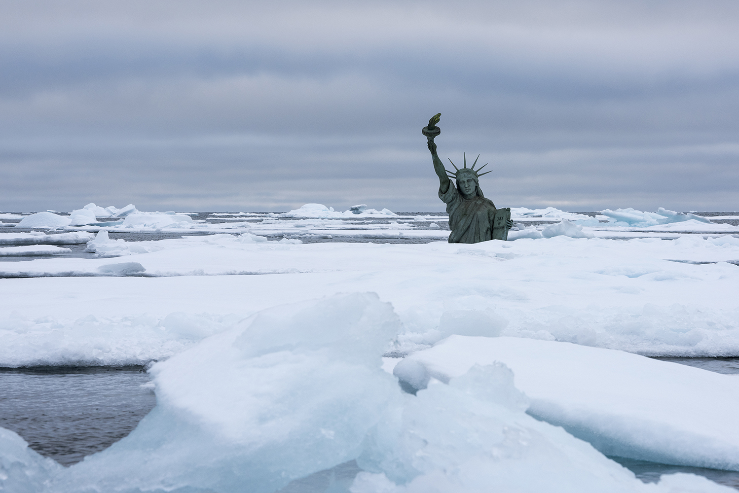 7/9 2014, Svalbard.A submerged Statue of Liberty in the middle of the Arctic Ocean visualises the effects of climate change on sea level rise and extreme weather events. Image is shot in the Arctic Ocean northwest of Svalbard, Norway during a Greenpeace ship tour as part of the Save the Arctic campaign, working to create an Arctic sanctuary.