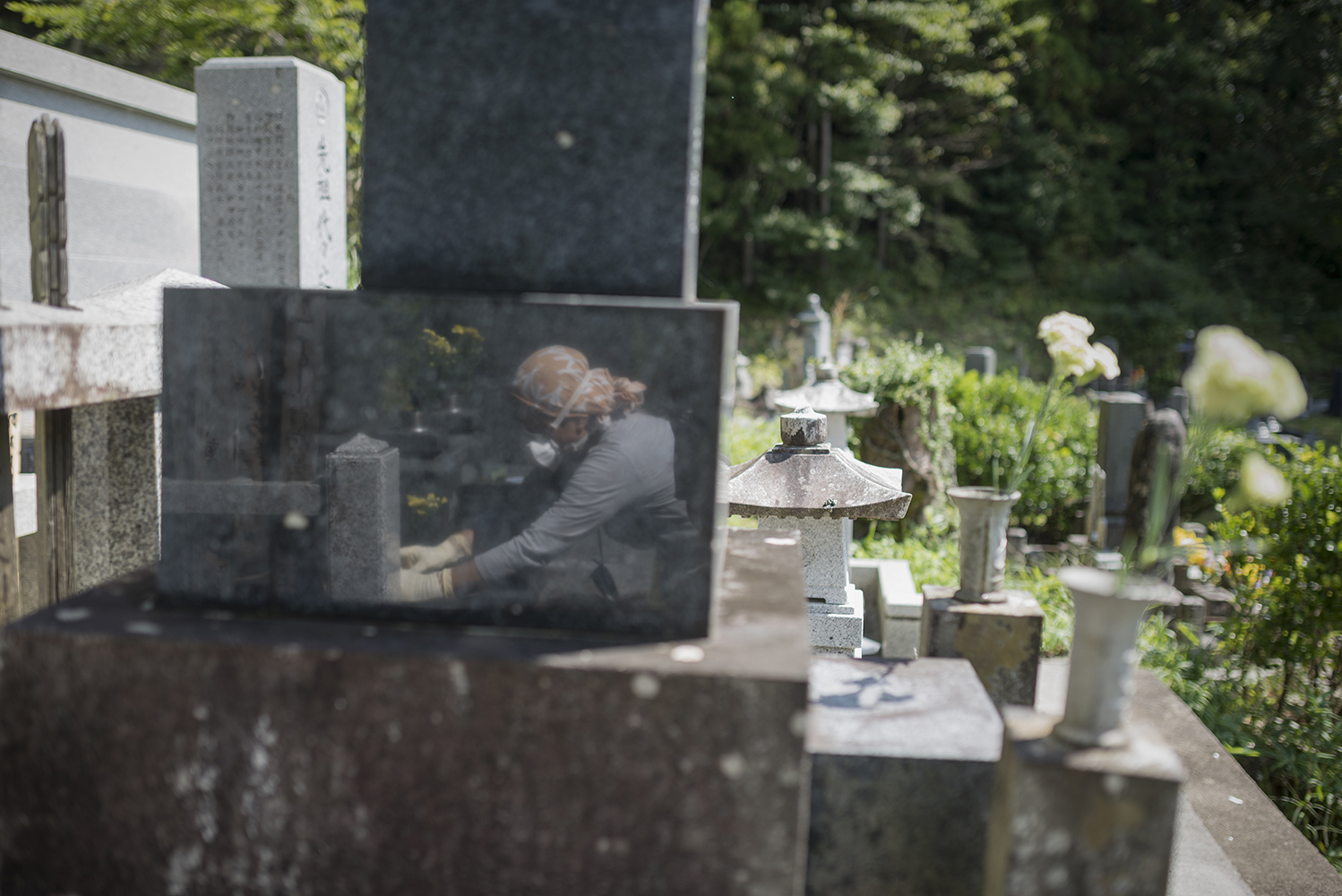 23 September 2017 - Evacuee and Fukushima survivor, Mrs Kanno at family grave in Tsushima, located in the exclusion zone of Namie, Fukushima prefecture. This area is closed for people to return to, however, the Japanese government plans to open a small area of Tsushima as early as 2023. The levels of radiation measured by Greenpeace in this highly contaminated area mean that it will be many decades and beyond the end of the century before radiation levels will even approach government targets.