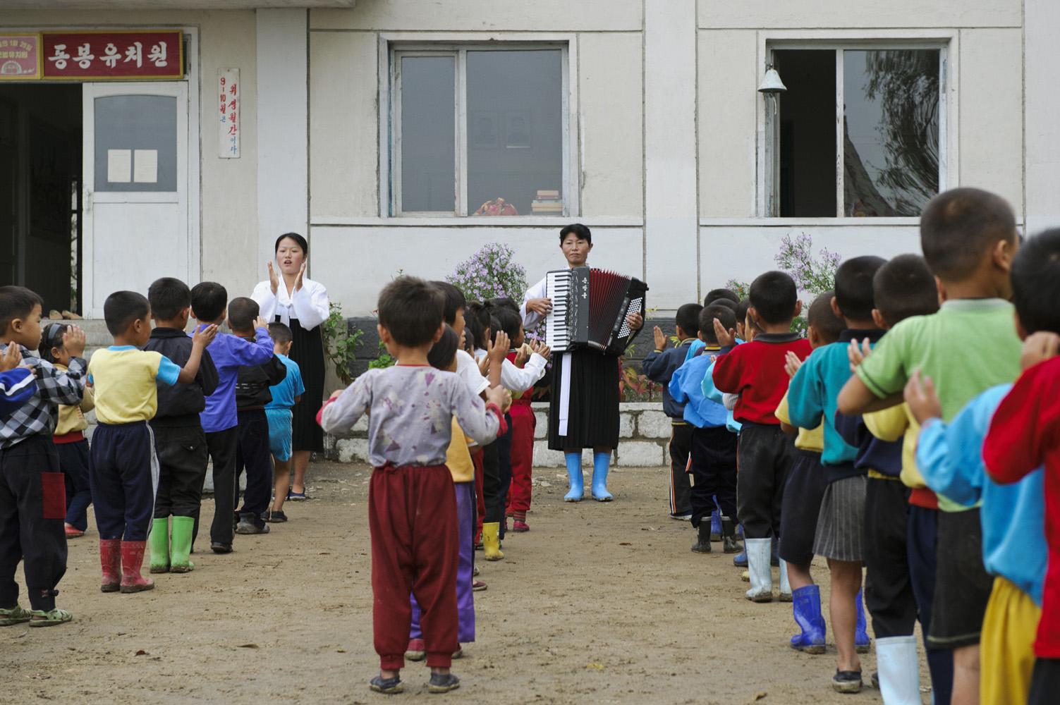 Teachers with school kids on a cooperative farm in Hamhung, South Hamgyŏng Province.