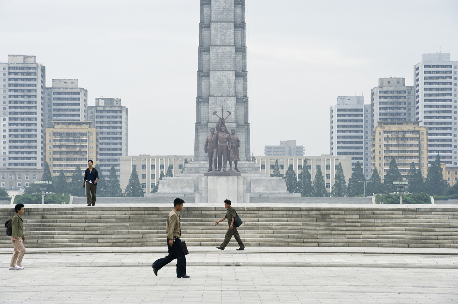 Kim Il-sung Square is a city square in Pyongyang, Democratic People's Republic of Korea, and is named after the founding leader of the DPRK, Kim Il-sung. Opened in August 1954, the square is located on the west bank of the Taedong River, directly opposite the Juche Tower on the other side of the river. The square is a common gathering place for rallies, dances and military parades and is often featured in media concerning North Korea. It is the 16th largest square in the world, having an area of about 75,000 square meters (807,293 square feet) which can accommodate a rally of more than 100,000 people.