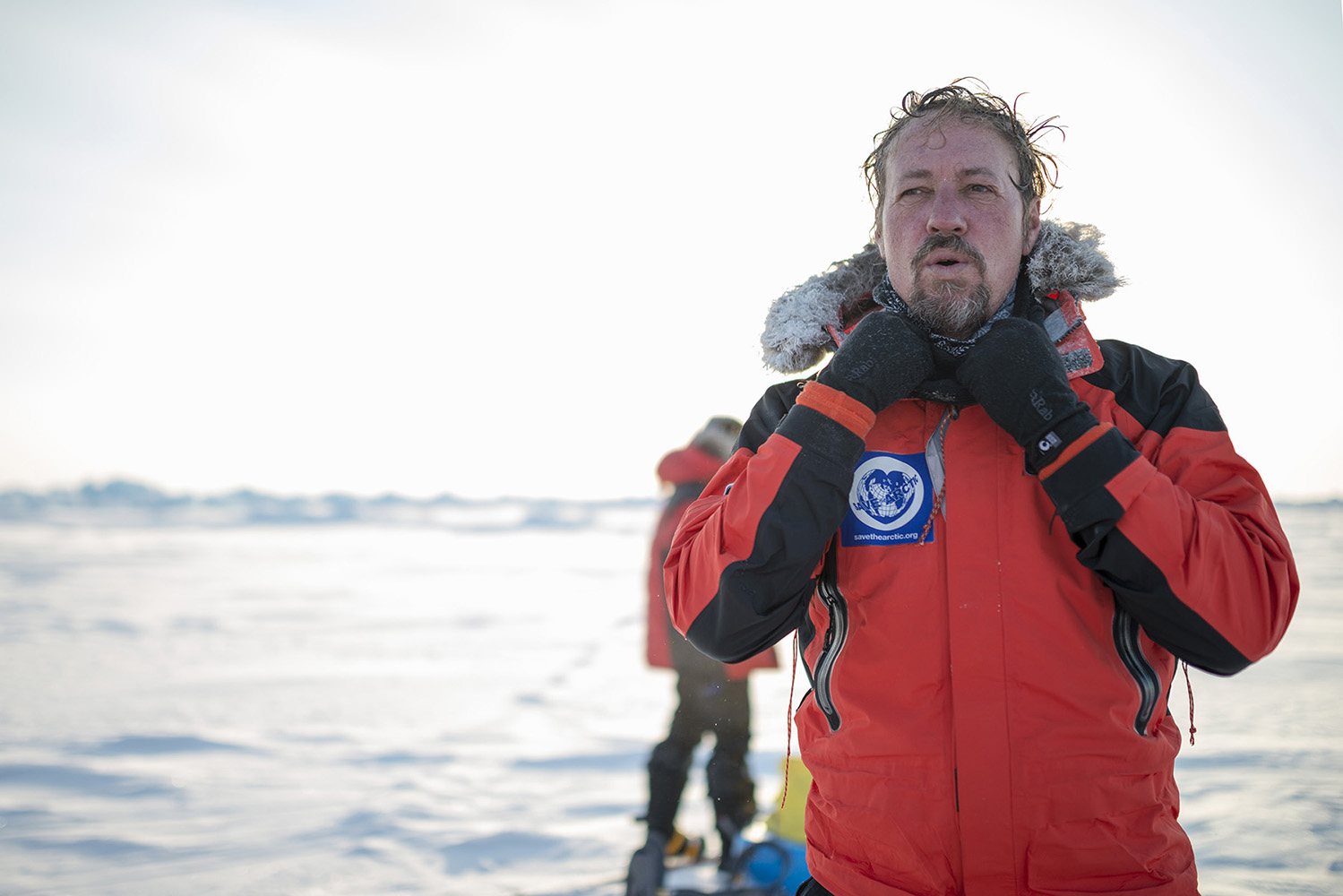 Adam Shore, Greenpeace Lead logistics coordinator, takes a break during the trek towards the North Pole.