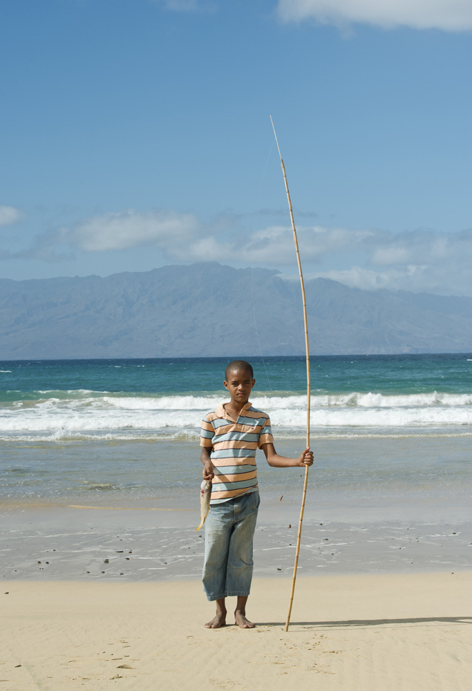 Salamanza, Sao Vicente, Cape Verde Young boy with fishing pole on the beach of Salamanza.